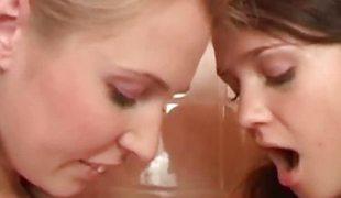Charming lesbian teens loving their own dildo