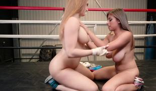 Sexy beauties are fucking each other while they are wrestling in the ring