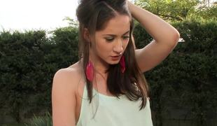 A brunette hair teen with a hawt ass is getting fucked in the garden