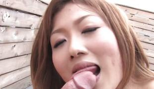 Japanese cock-teaser blows and eats cum