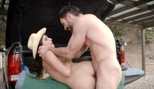 Cowgirl with lengthy curly hair gets drilled by a lascivious farmer