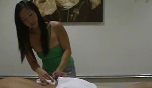 Busty Asian babe gives nice massage and handjob