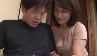 Mature Japanese seductress Yuuri Saejima copulates dispirited dude