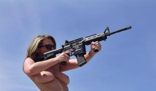 Naked pornstars shooting guns and fucking in the desert