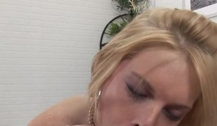 A fun loving blonde removes her underware and gives a cock a kiss