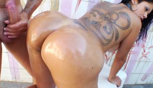 Collared Brazilian girl with a large back tattoo wants anal sex
