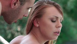 Making doggystyle love to a slender juvenile redhead outdoors